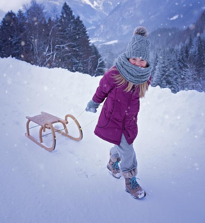 kind fotograferen in sneeuw